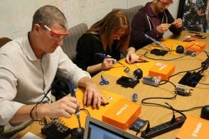 Group of teachers soldering project