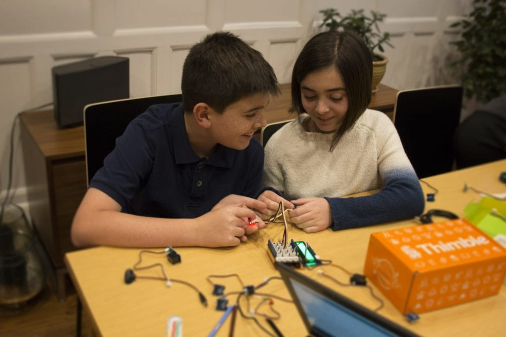 Boy and girl build Arduino projects with Thimble