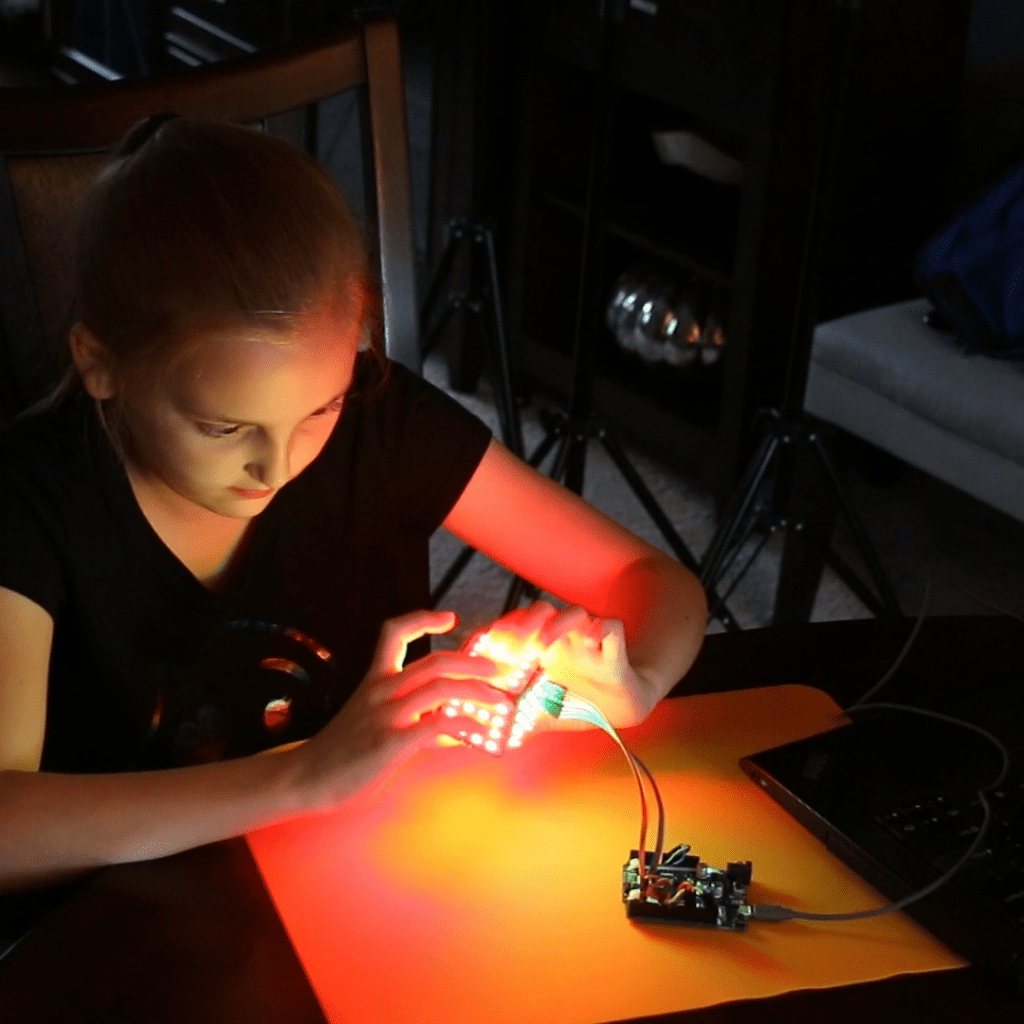 girl building stem subscription box project