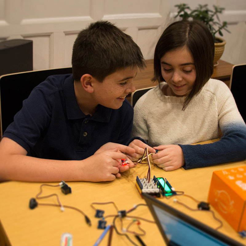 boy and girl building STEM project