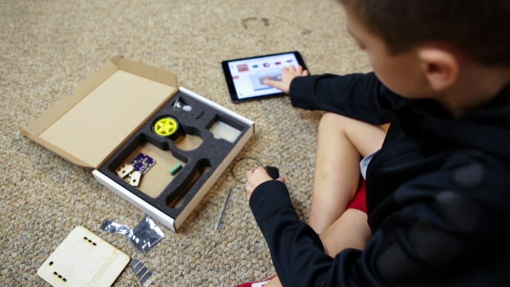 boy opens kit of technical components