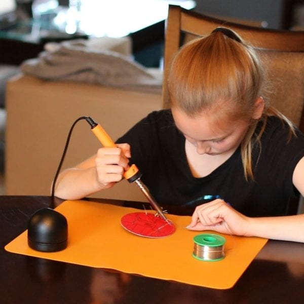 girl building science project
