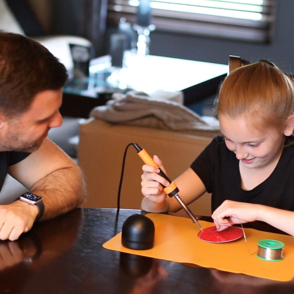 dad and daughter building STEM project together