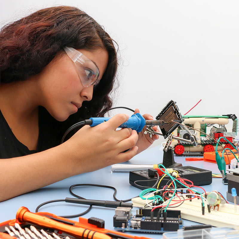 girl soldering project