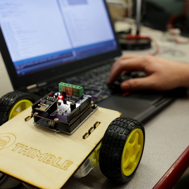 WiFi robot and hand typing on computer