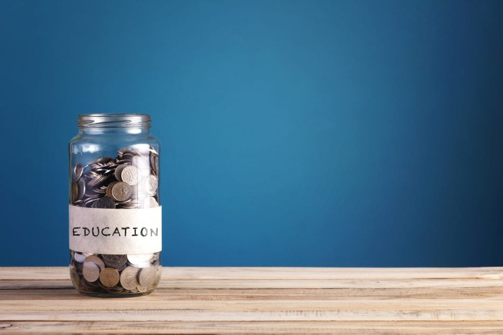a small jar with little money for education