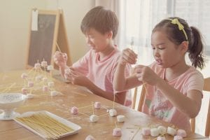 kids working on science project together
