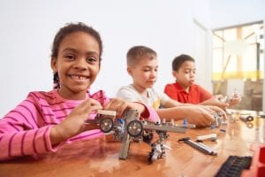 kids working on machine projects