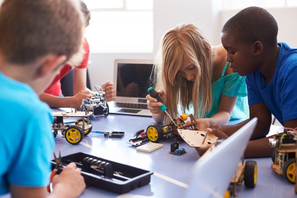 group of students soldering projects