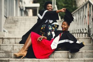 two black female students sitting on the steps at campus