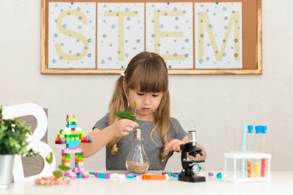 girl working on STEM projects on her desk