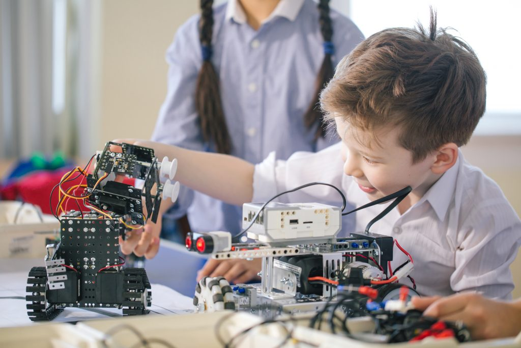 young boy building robotics projects