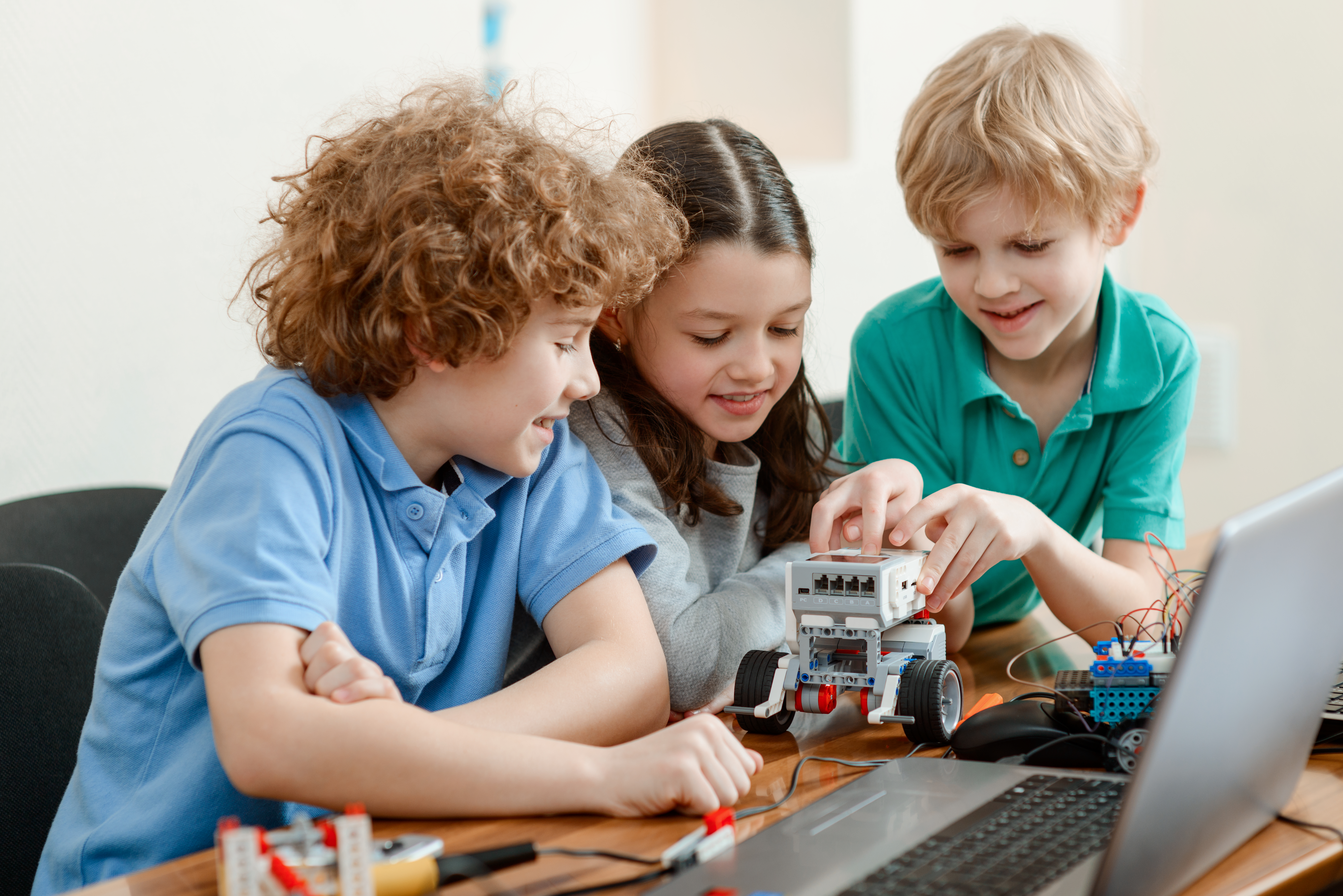 young kids building a robot together