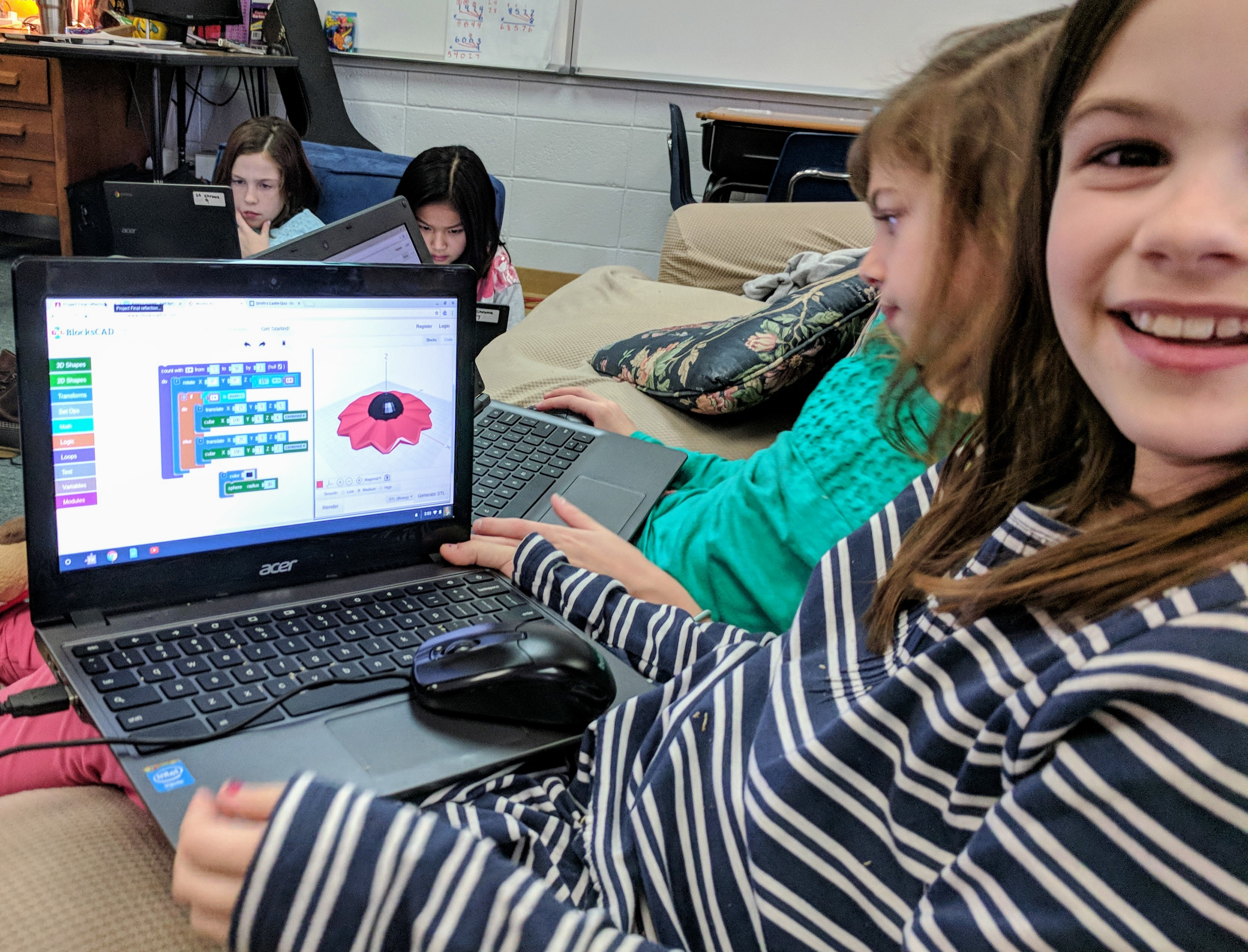 girls learning to code on laptop