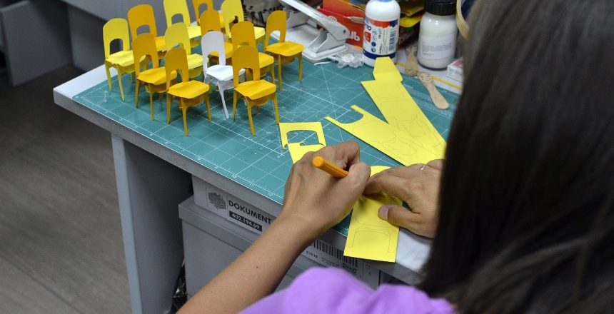 teacher creating paper chairs from scratch