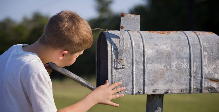 boy checking the mail