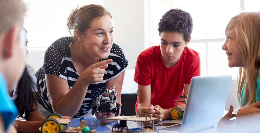 female teacher building various electronic projects with her students
